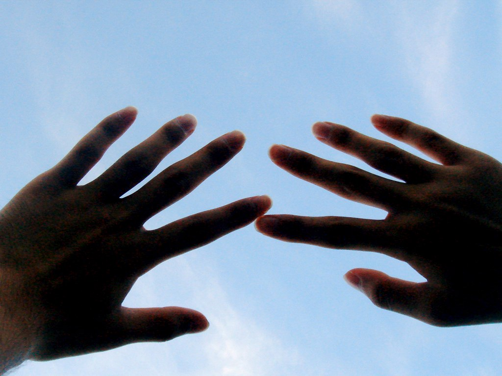 Picture of hands held to the sky
