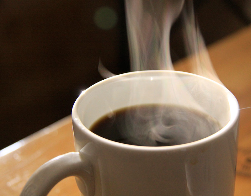 Picture of a cup of coffee with steam rising